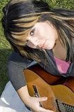 Girl Playing a Guitar Stock Photography