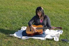Girl Playing a Guitar Stock Photos