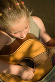 Girl playing guitar Stock Image