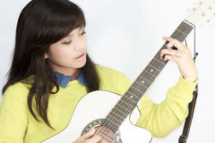 Girl Playing Guitar Royalty Free Stock Photos