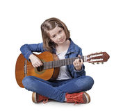 Girl playing the guitar royalty free stock images