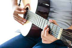 Girl playing guitar - Focus hand. Stock Image