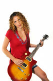 Girl playing guitar isolated Royalty Free Stock Image