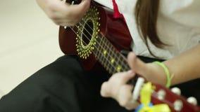 Girl playing guitar stock video
