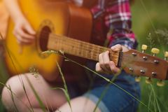 Girl Playing Guitar Out In Nature. Stock Photo