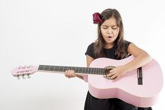 Girl playing guitar and sing Royalty Free Stock Image