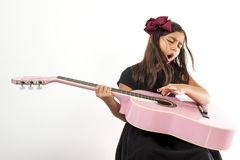 Girl playing guitar and sing. Cute young girl playing guitar and sing Stock Photography