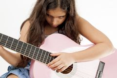 Girl playing guitar and sing. Cute young girl playing guitar and sing Royalty Free Stock Photos