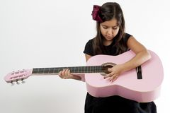 Girl playing guitar and sing. Cute young girl playing guitar and sing Royalty Free Stock Photography