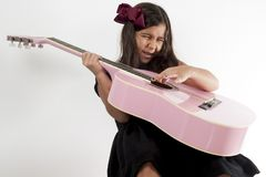 Girl playing guitar and sing. Cute young girl playing guitar and sing Royalty Free Stock Image