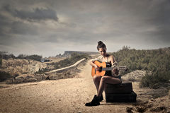 Girl playing guitar stock photo