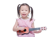 Girl playing guitar toy over white Royalty Free Stock Photos