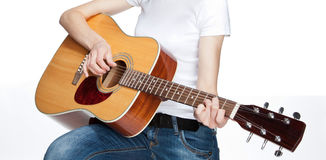 Girl playing on guitar. On white background Stock Photos