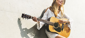 Girl Playing Guitar Writing Song Concept Stock Photo