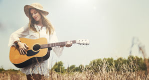 Girl Playing Guitar Writing Song Concept. Outdoor Girl Playing Guitar Concept Royalty Free Stock Photography