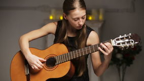 Girl playing the guitar stock video