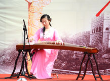 Girl  playing GuZheng Stock Photo
