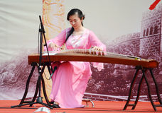 Girl  playing GuZheng Royalty Free Stock Photo