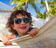 Girl playing hammock Royalty Free Stock Photos