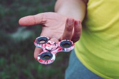 Girl playing with Hand Spinner toy, girl holding Spinner on one finger stock photos