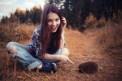 Girl playing with a hedgehog Royalty Free Stock Photo