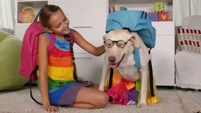 Girl playing with her clever dog - preparing for school