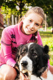 Girl playing with her  dog Stock Image