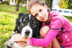 Girl playing with her  dog Royalty Free Stock Images