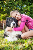 Girl playing with her  dog Royalty Free Stock Image