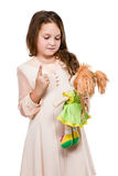 Girl playing with her doll Stock Image