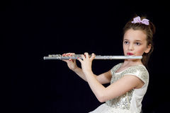 Girl Playing her Flute Stock Images