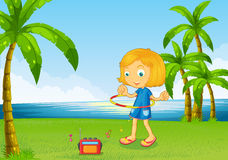 A girl playing with her hoop near the river Royalty Free Stock Images