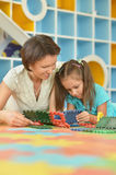Girl playing with her mother Stock Photography