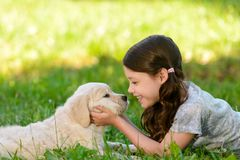 Girl playing with her pet stock photos