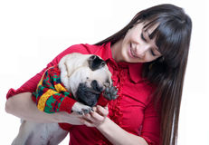 Girl playing with her pug dog Royalty Free Stock Images
