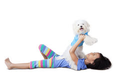 Girl Playing with her Puppy Royalty Free Stock Images