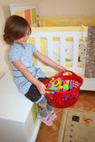 Girl playing with her toy Royalty Free Stock Images
