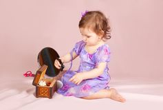 Girl playing with her toys Stock Photography
