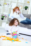 Girl playing with her toys Stock Images