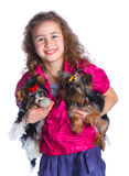 Girl playing with her yorkshire terrier Royalty Free Stock Photography