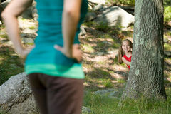 Girl playing hide and seek Stock Image