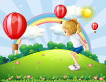 A girl playing in the hill with floating balloons. Illustration of a girl playing in the hill with floating balloons Royalty Free Stock Photo