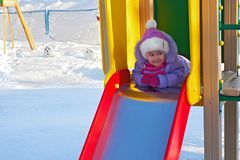 Girl is playing on hill. In kindergarten royalty free stock photography
