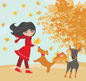 Girl playing with his dogs in autumn Royalty Free Stock Photos