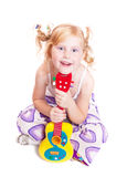 Girl playing his toy guitar Royalty Free Stock Images