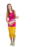 Girl playing his toy guitar Royalty Free Stock Photos