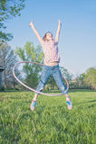 Girl playing hoola- hoop jumping Royalty Free Stock Photography