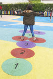 Girl playing hopscotch Royalty Free Stock Photography