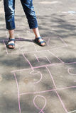 Girl playing in hopscotch outdoors Royalty Free Stock Image