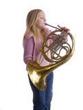 Girl Playing Horn Stock Photos